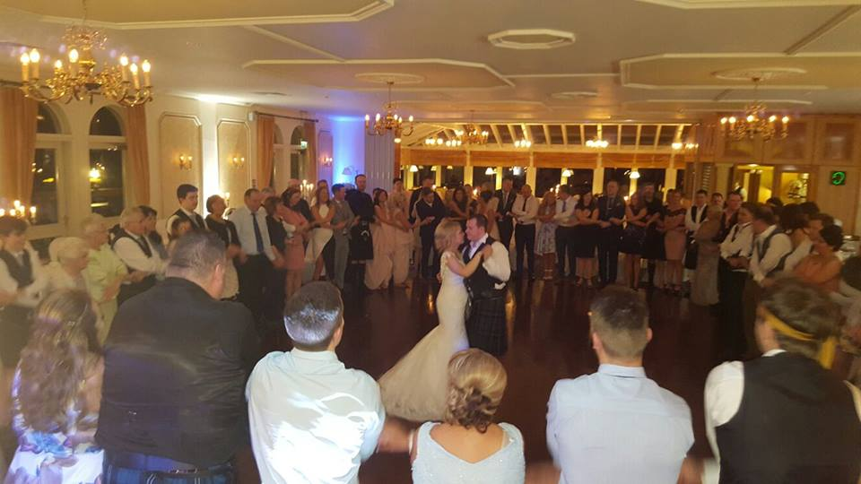 newly weds embrace on dancefloor at their wedding