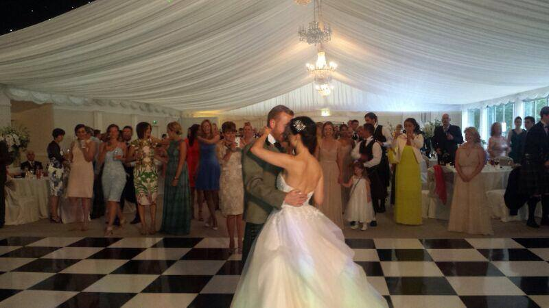 newly weds embrace on dancefloor for first dance