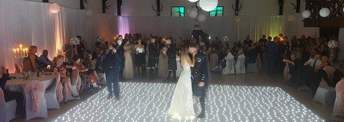newly weds embrace on the dancefloor